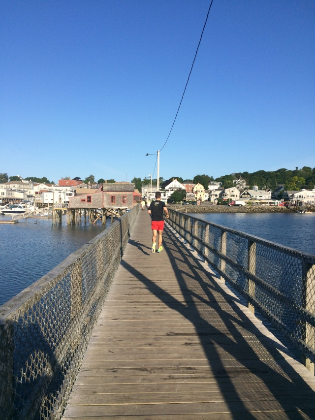 Running across the Boothbay pedestrian bridge