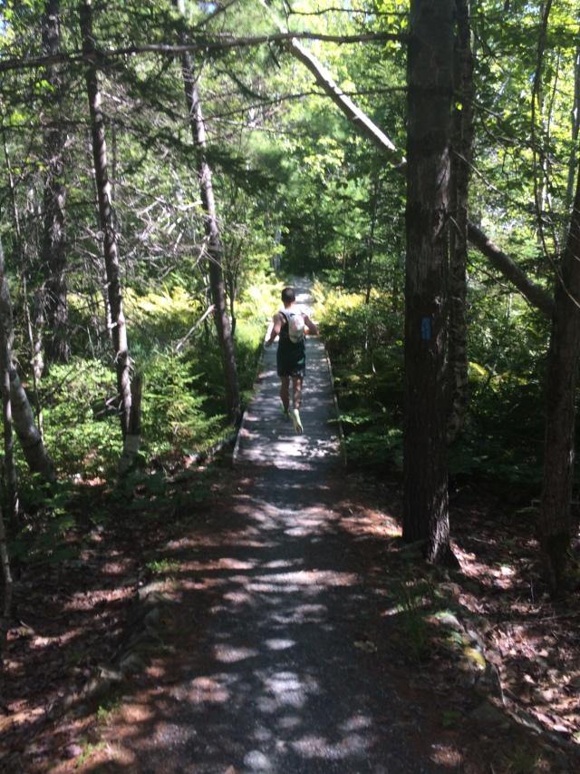 Running across a bridge on access trail